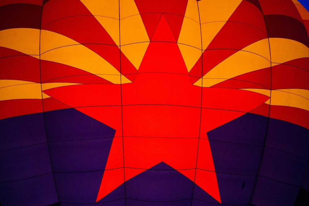 red, yellow, and purple hot air balloon macro photography