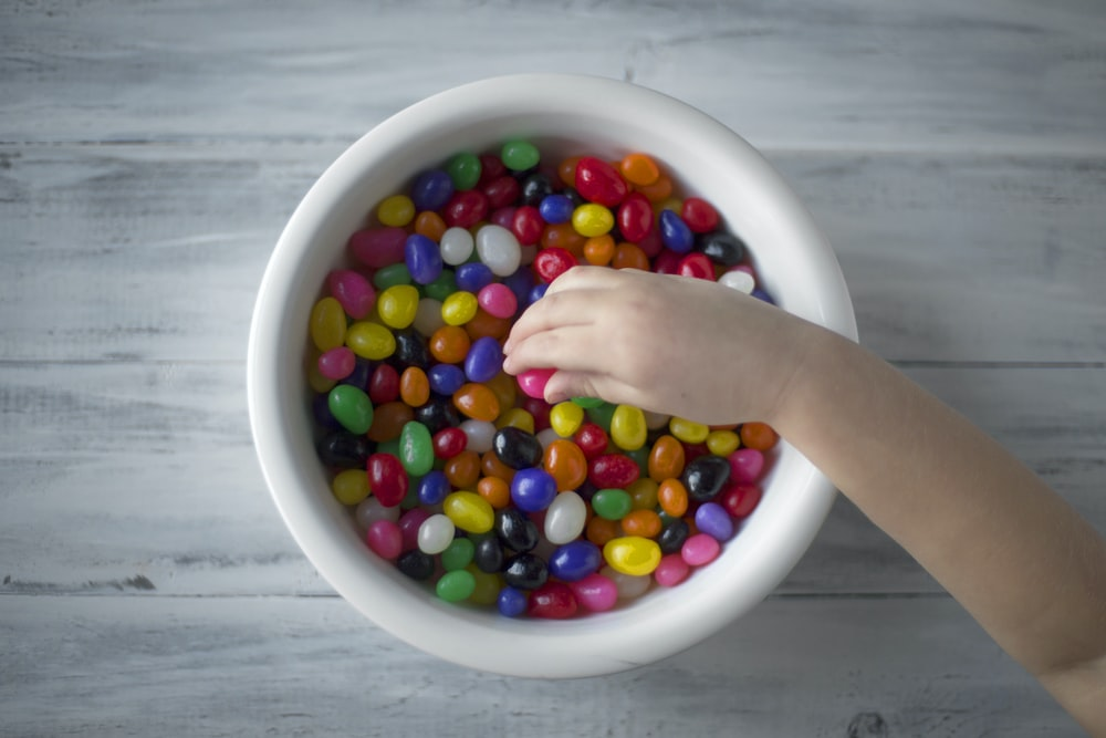 multicolored candies on white ceramic bowl
