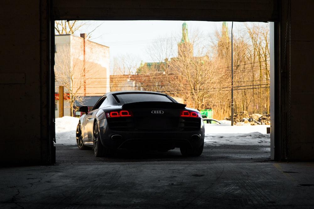 silver car beside wall