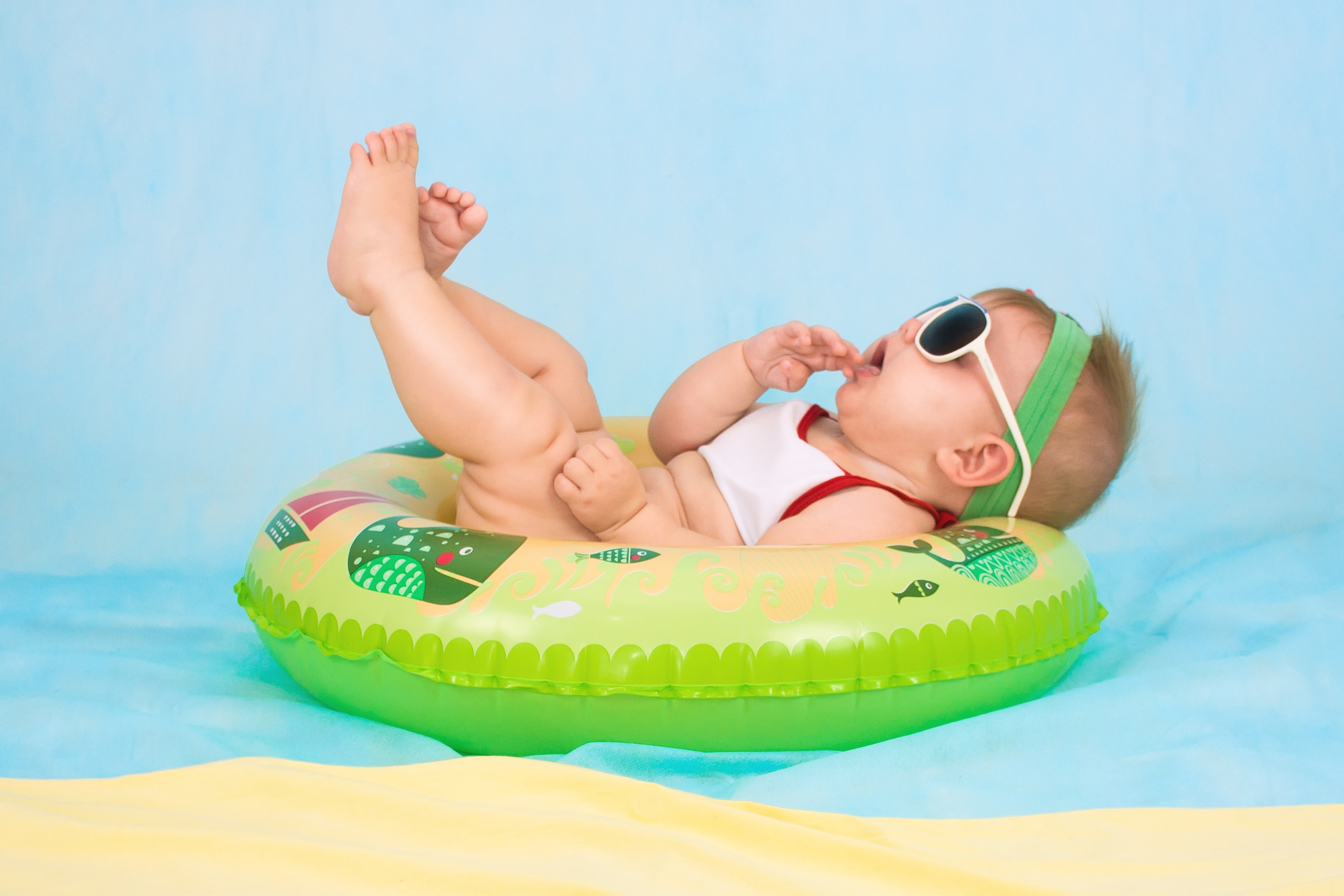 baby lying on inflatable ring
