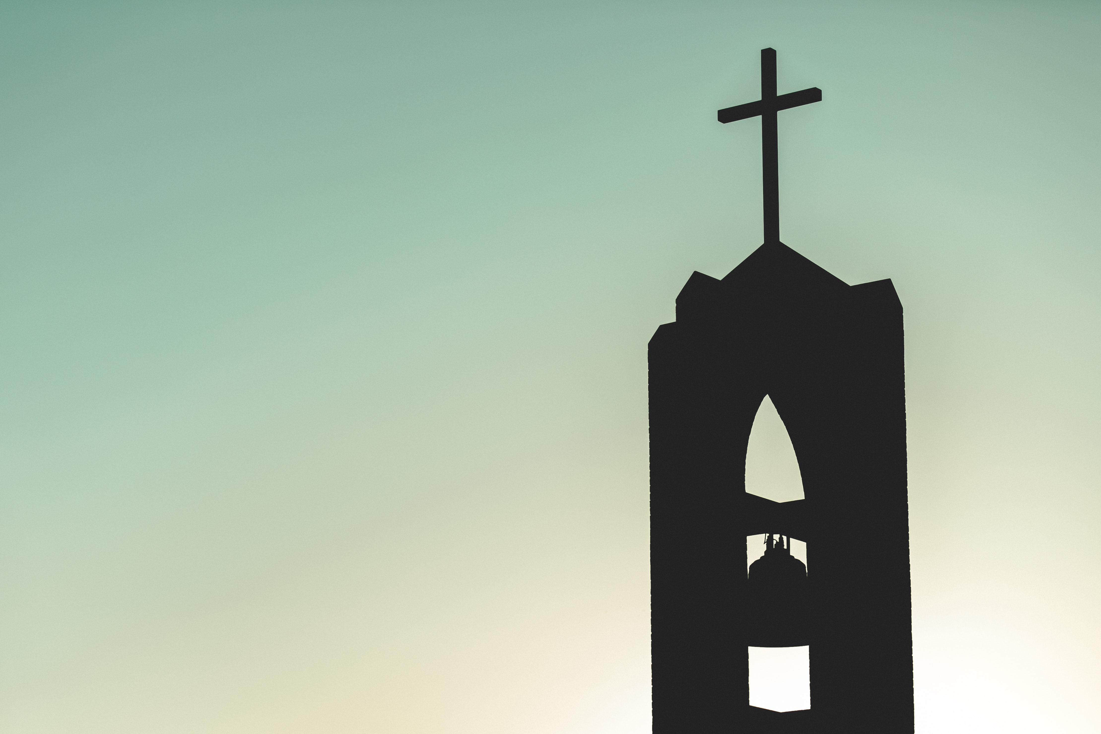 silhouette photo of church bell