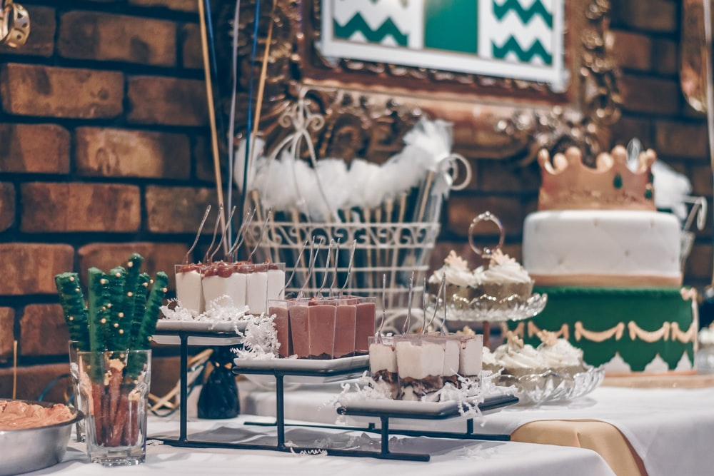 assorted desserts on top of table