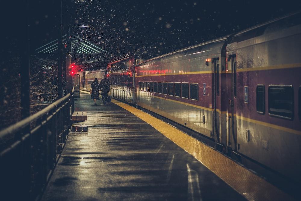 couple walking on train station