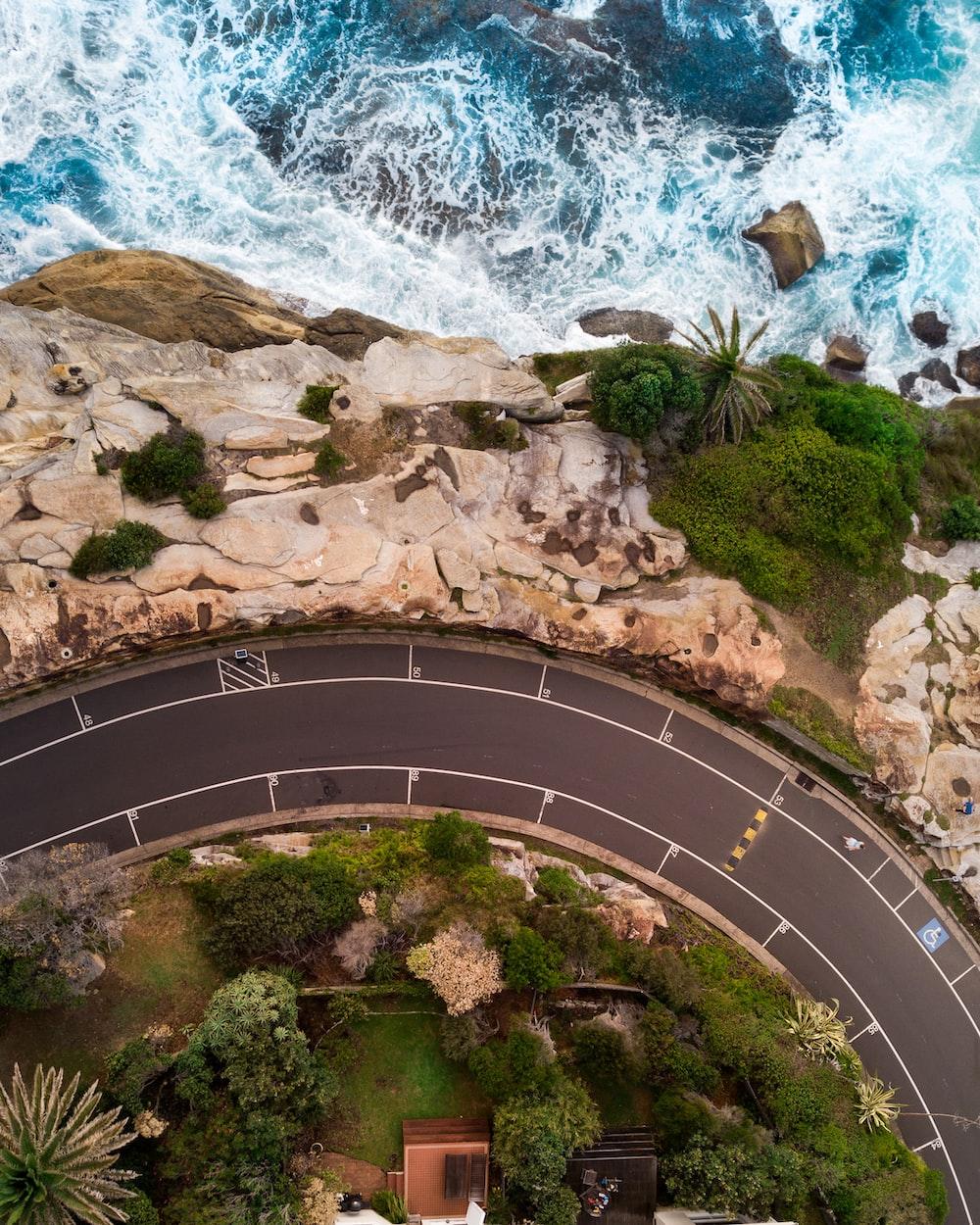aerial photography of raceway road near coastal area