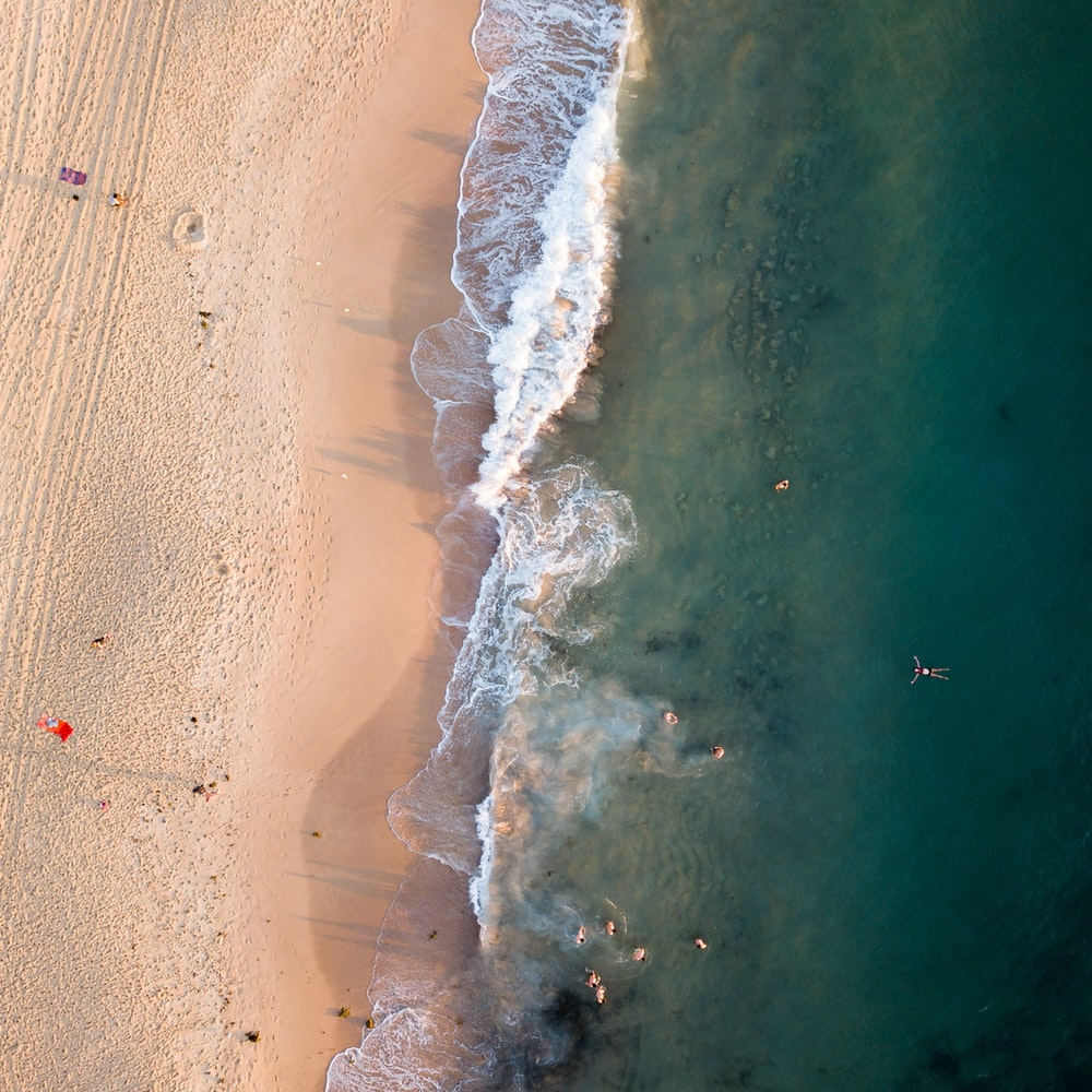 aerial photography of sea waves in the shore