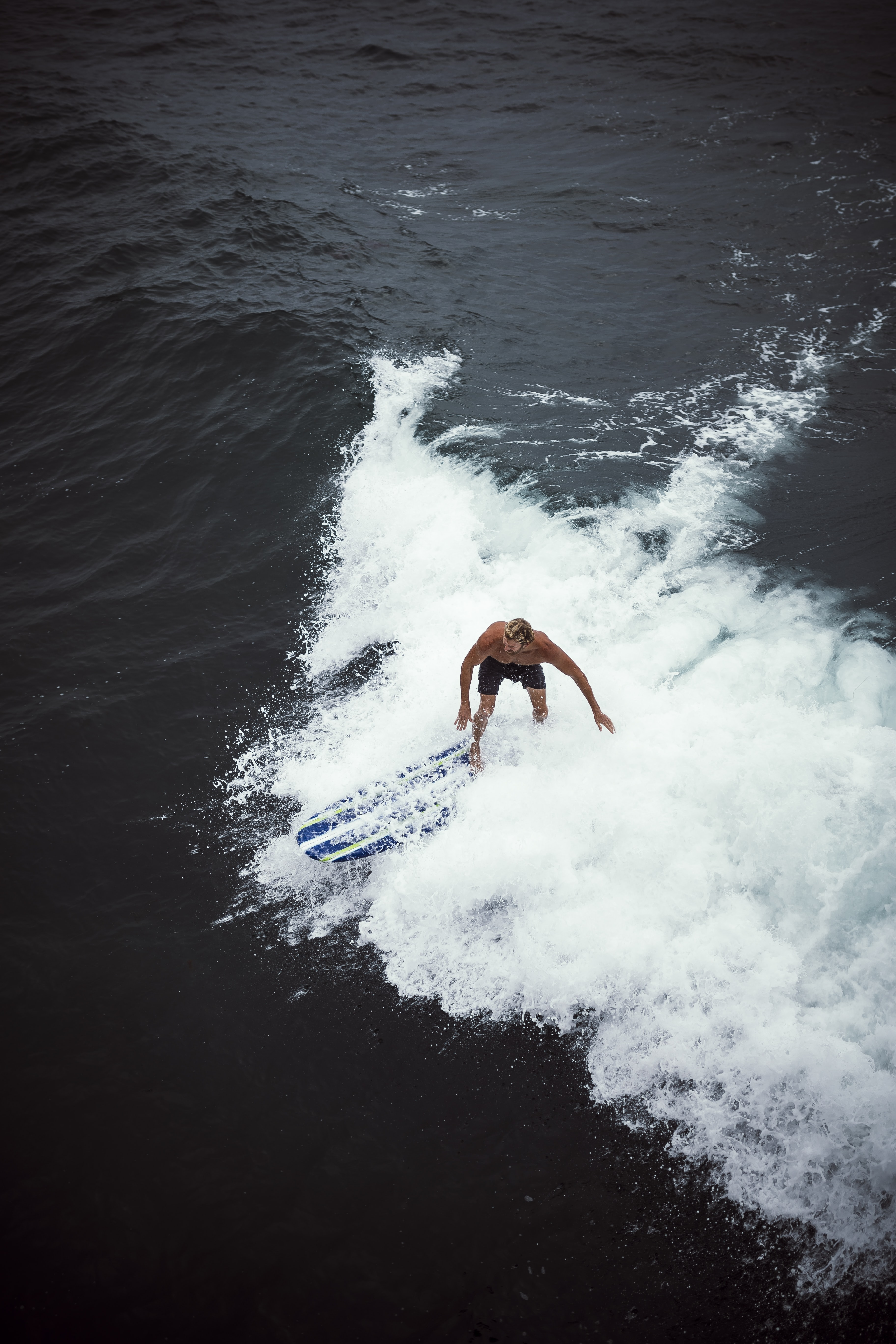 person surfboarding on waves