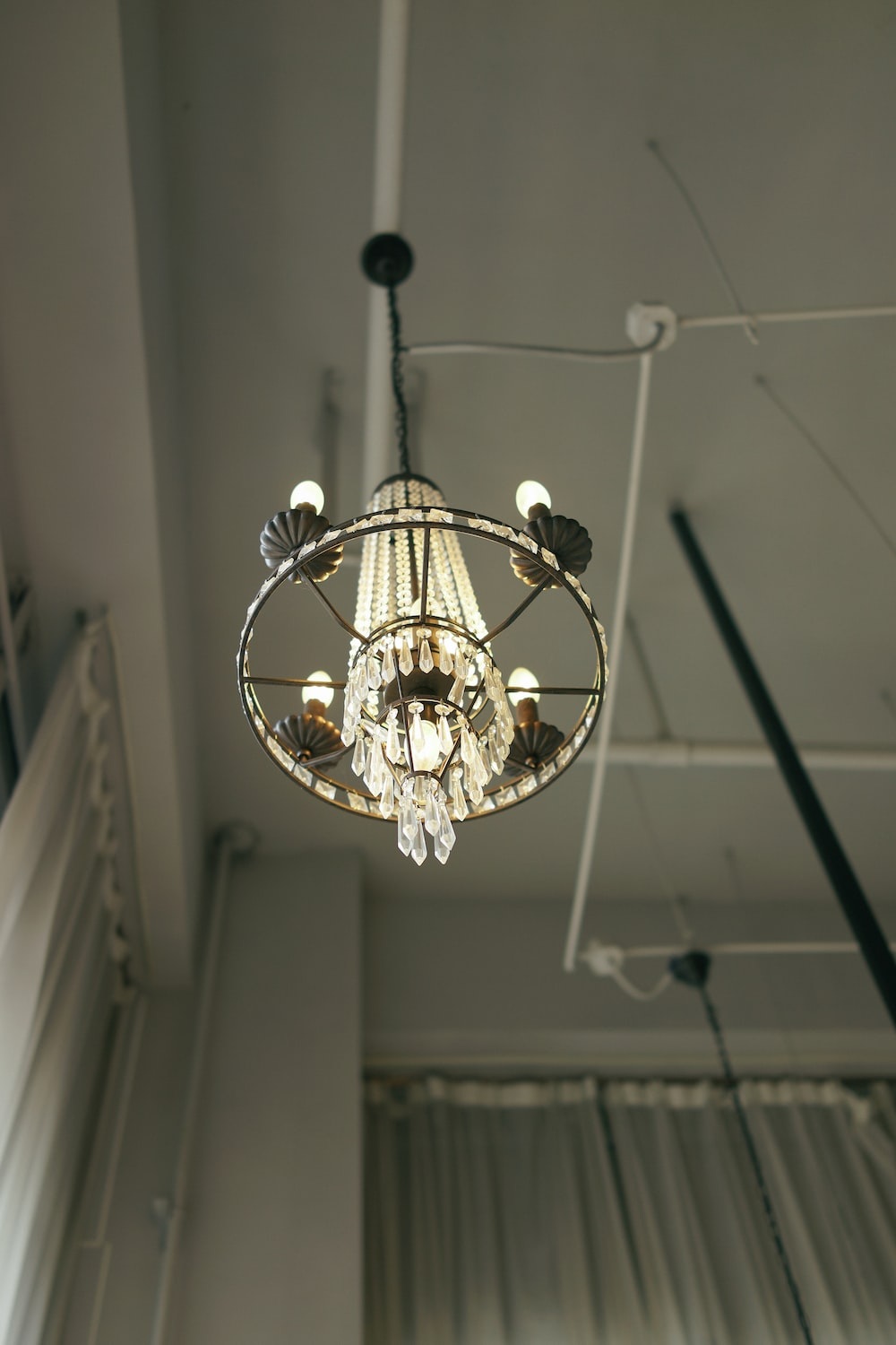 low-angle photography of glass chandelier