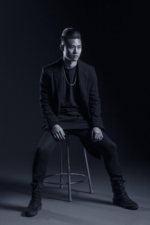 man sitting on stool inside room