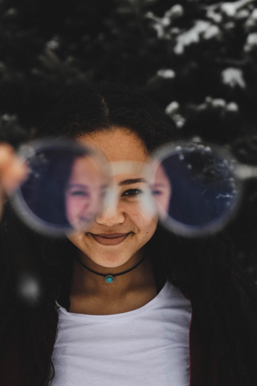 woman through eyeglasses photograph