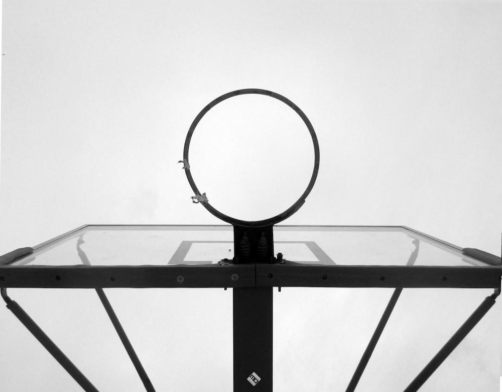 low angle photograph ogblack and white basketball hoop