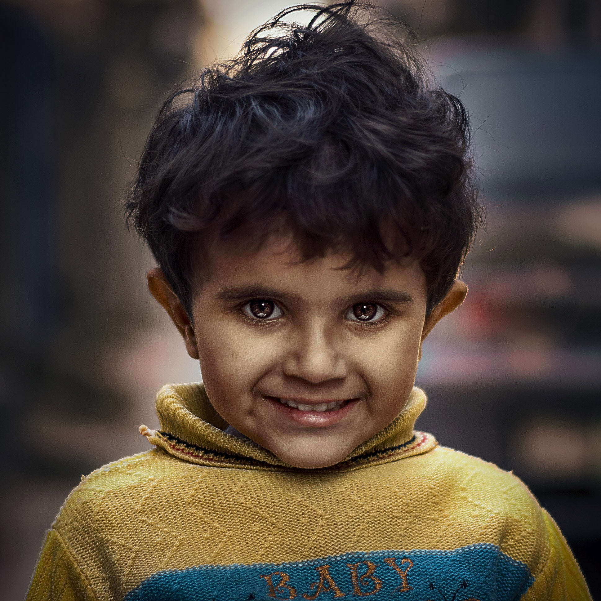 boy wearing yellow sweater selective focus photography