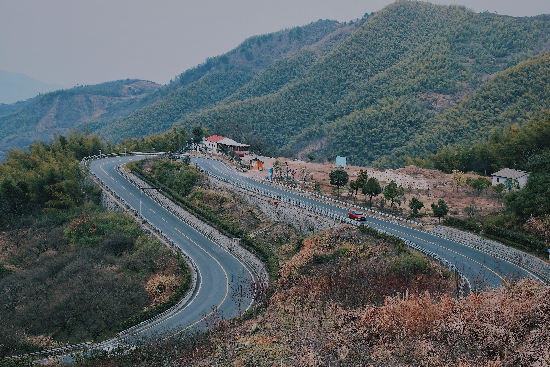 gray concrete road on mountain