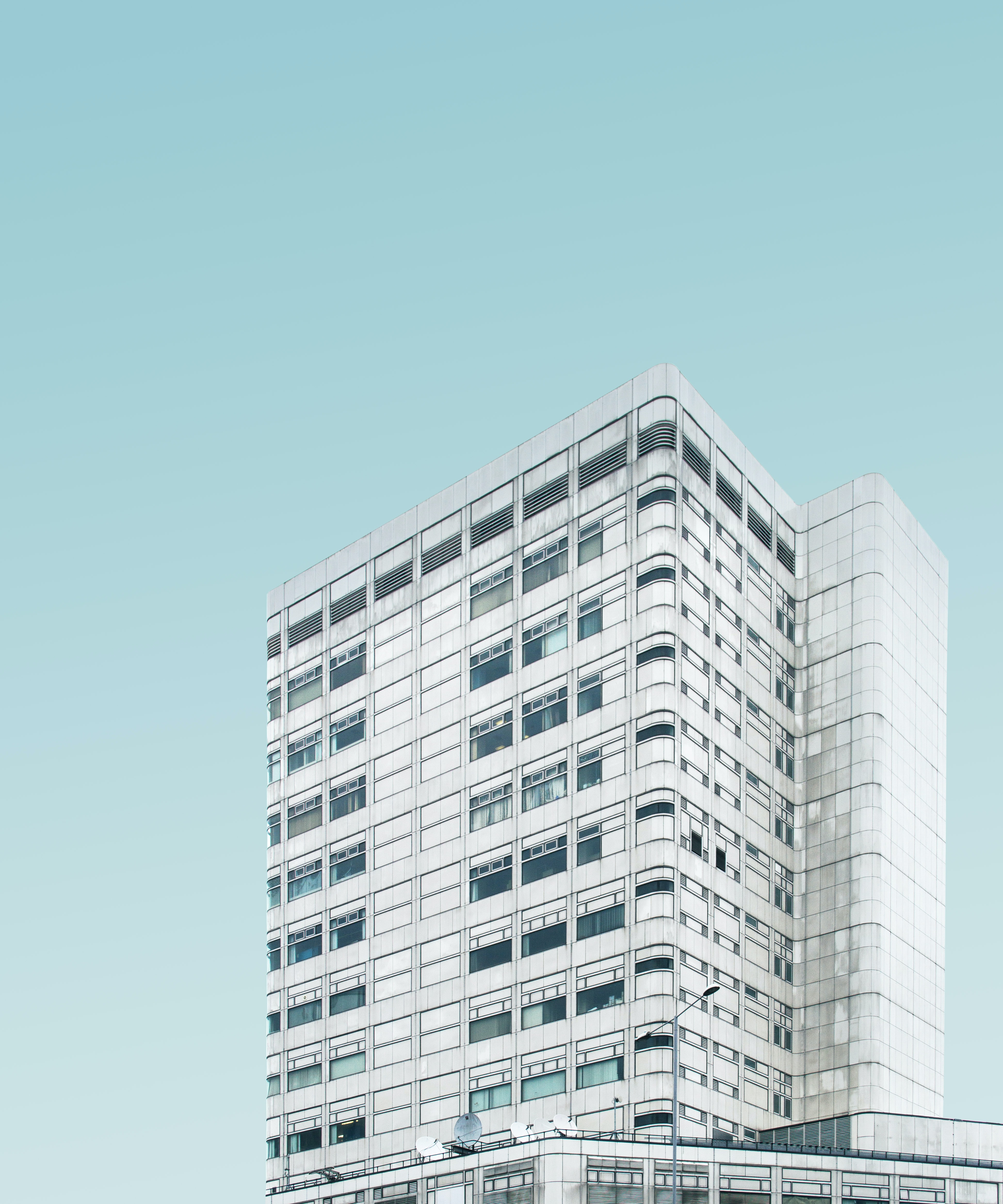 architectural photography of white concrete high-rise building
