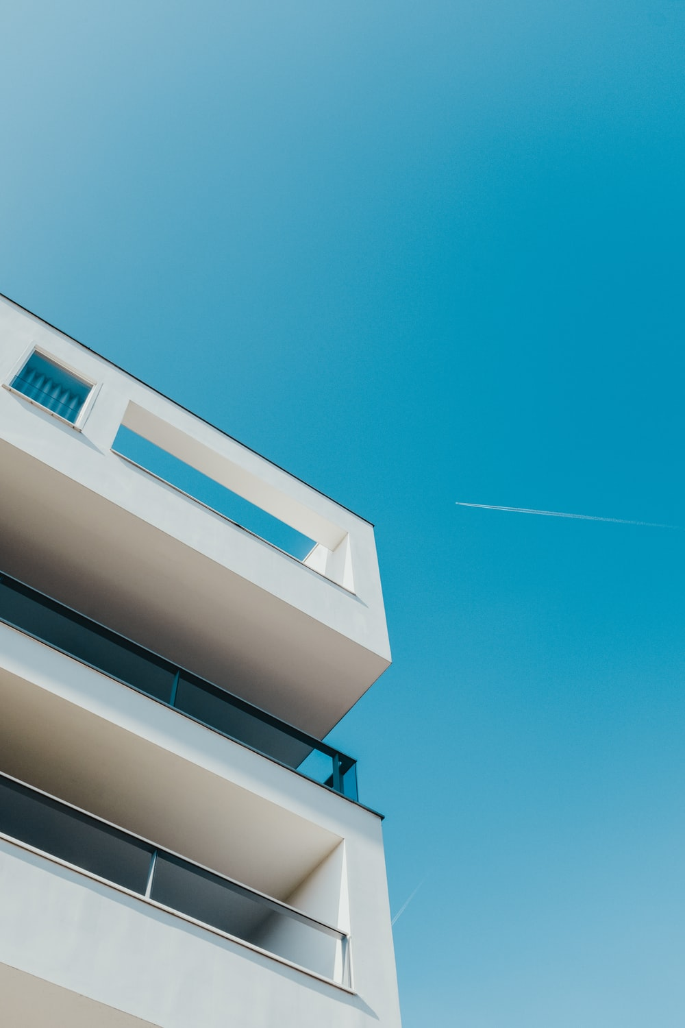 low-angle photography of white building