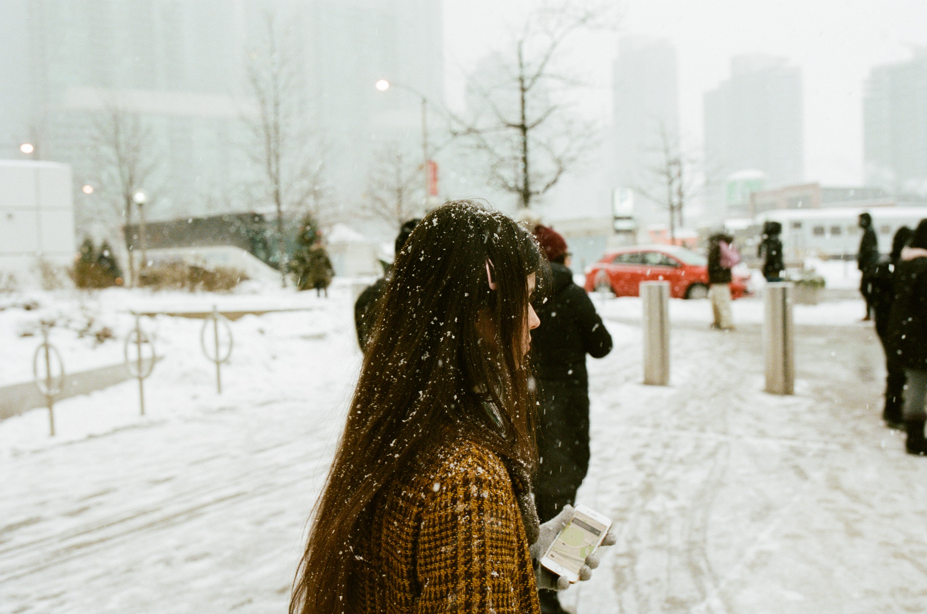 woman walking in snow covered street