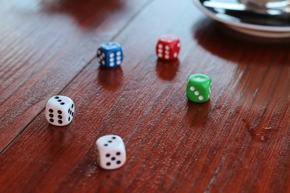 five assorted-color dice