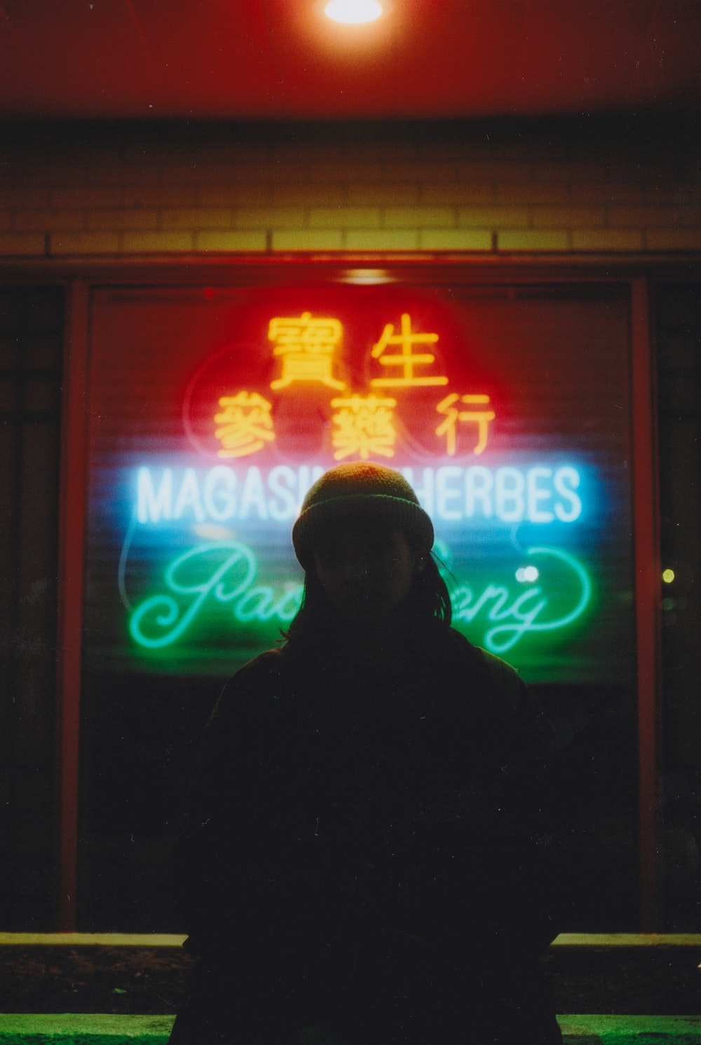 person standing in front of LED signage