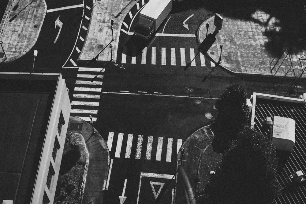 grayscale aerial photo of pedestrian