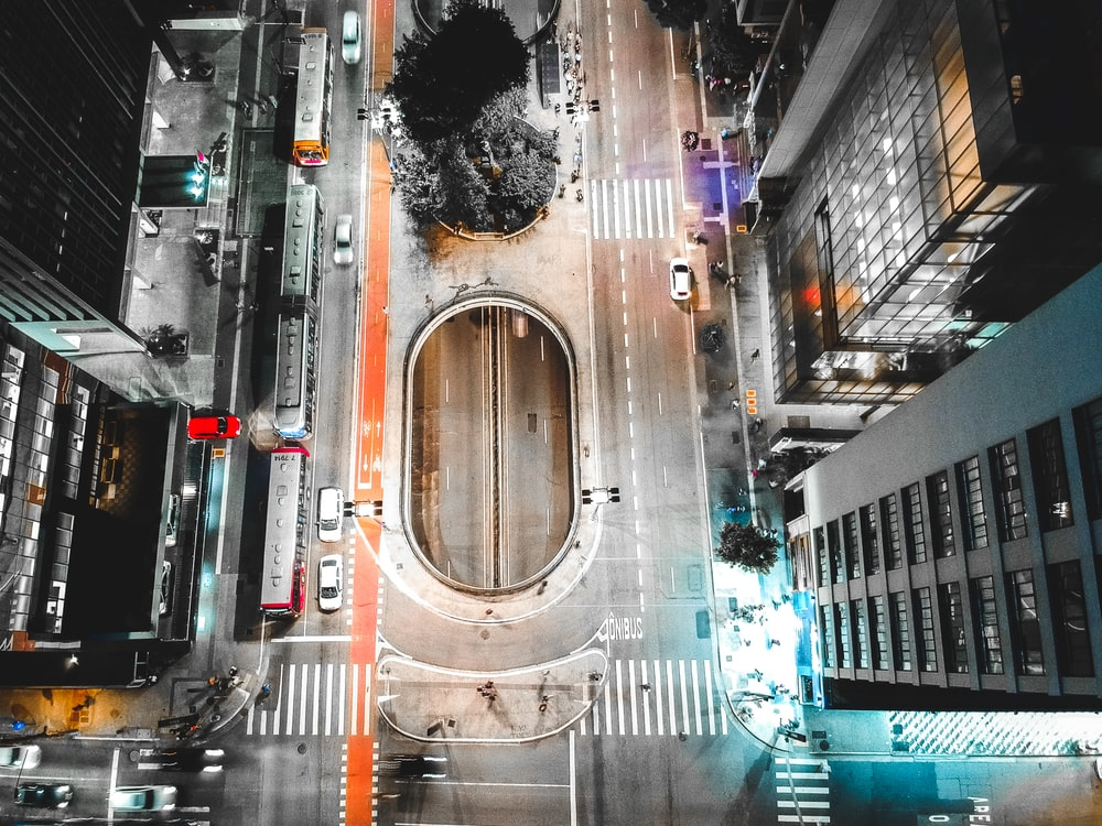 aerial photography of road between buildings at daytime