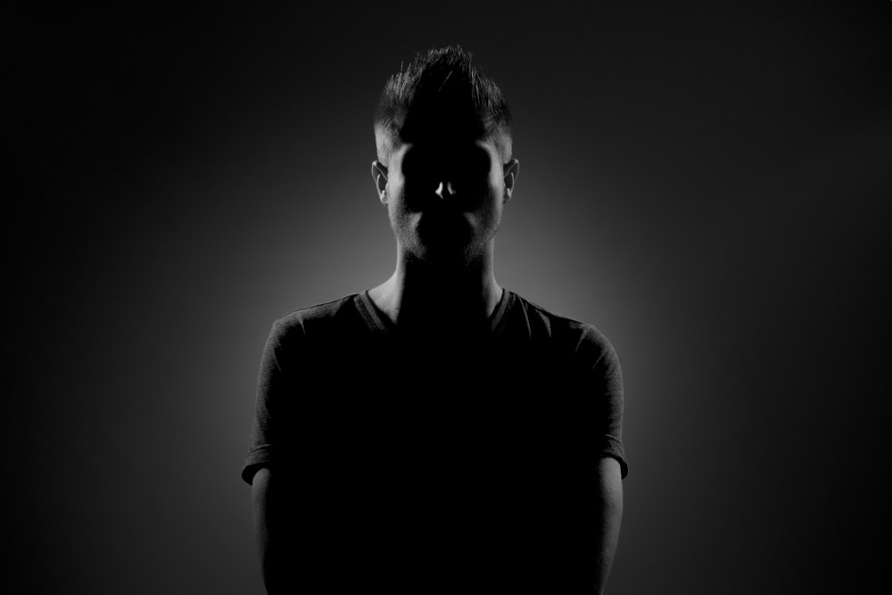 grayscale photography of man wearing black t-shirt