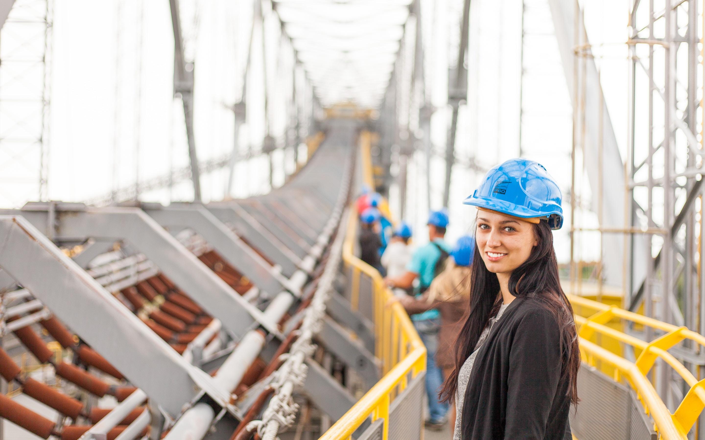 woman standing on metal bridge