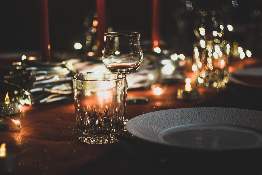 selective focus photography of wine glass and shot glass on table