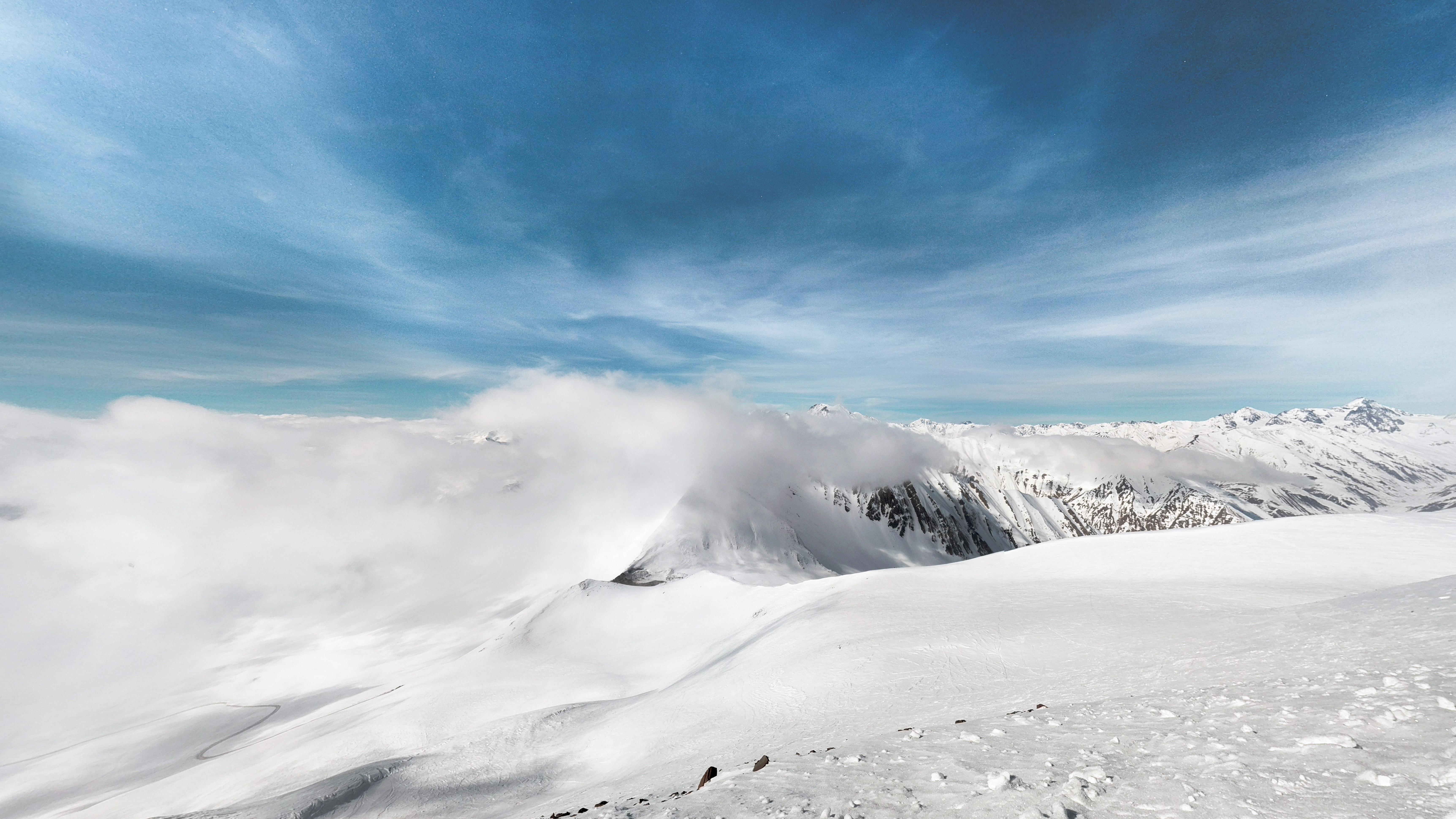 smoking snow-covered mountain
