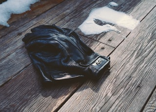 leather bag on wooden surface
