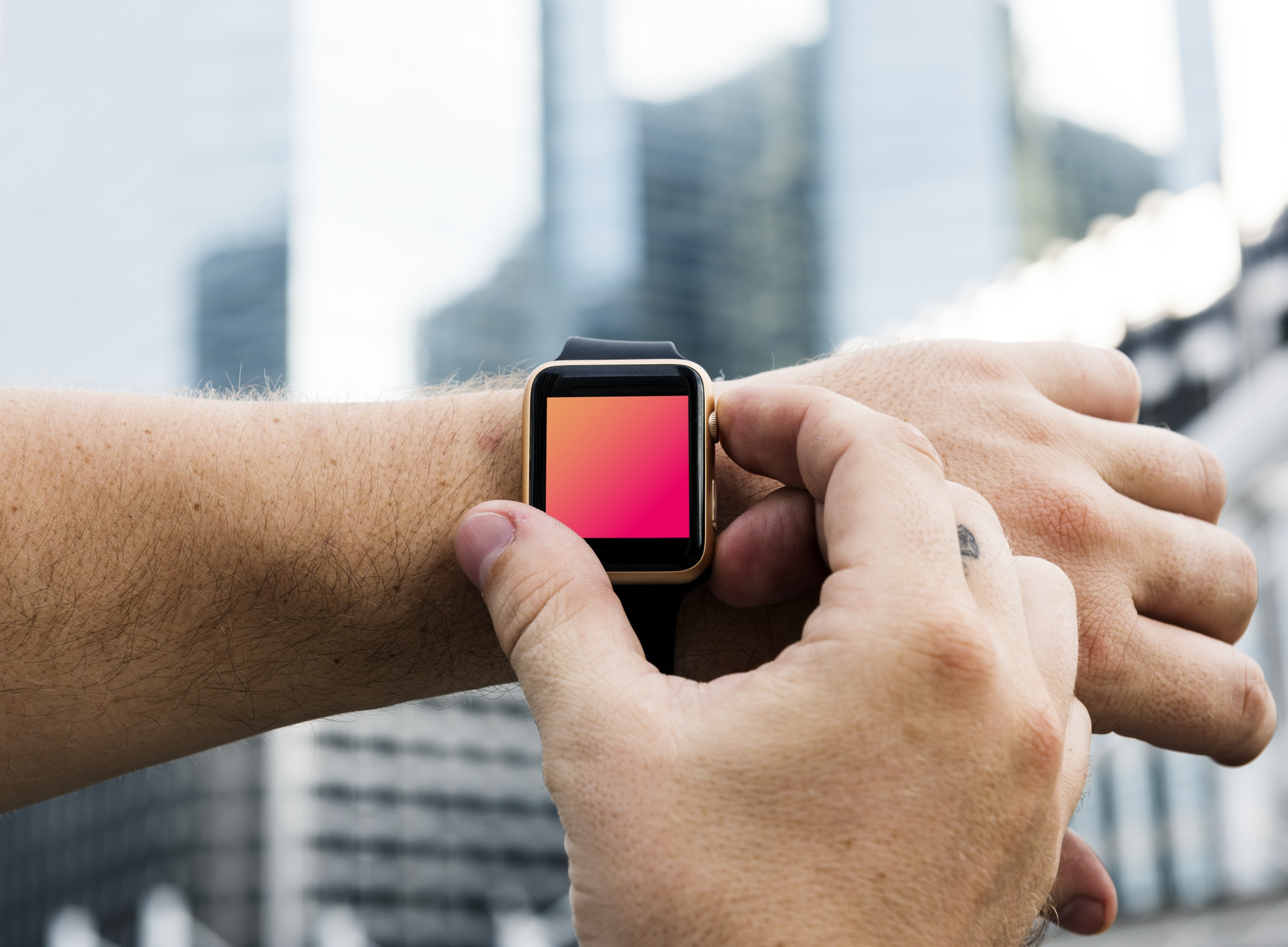 person holding square silver smartwatch