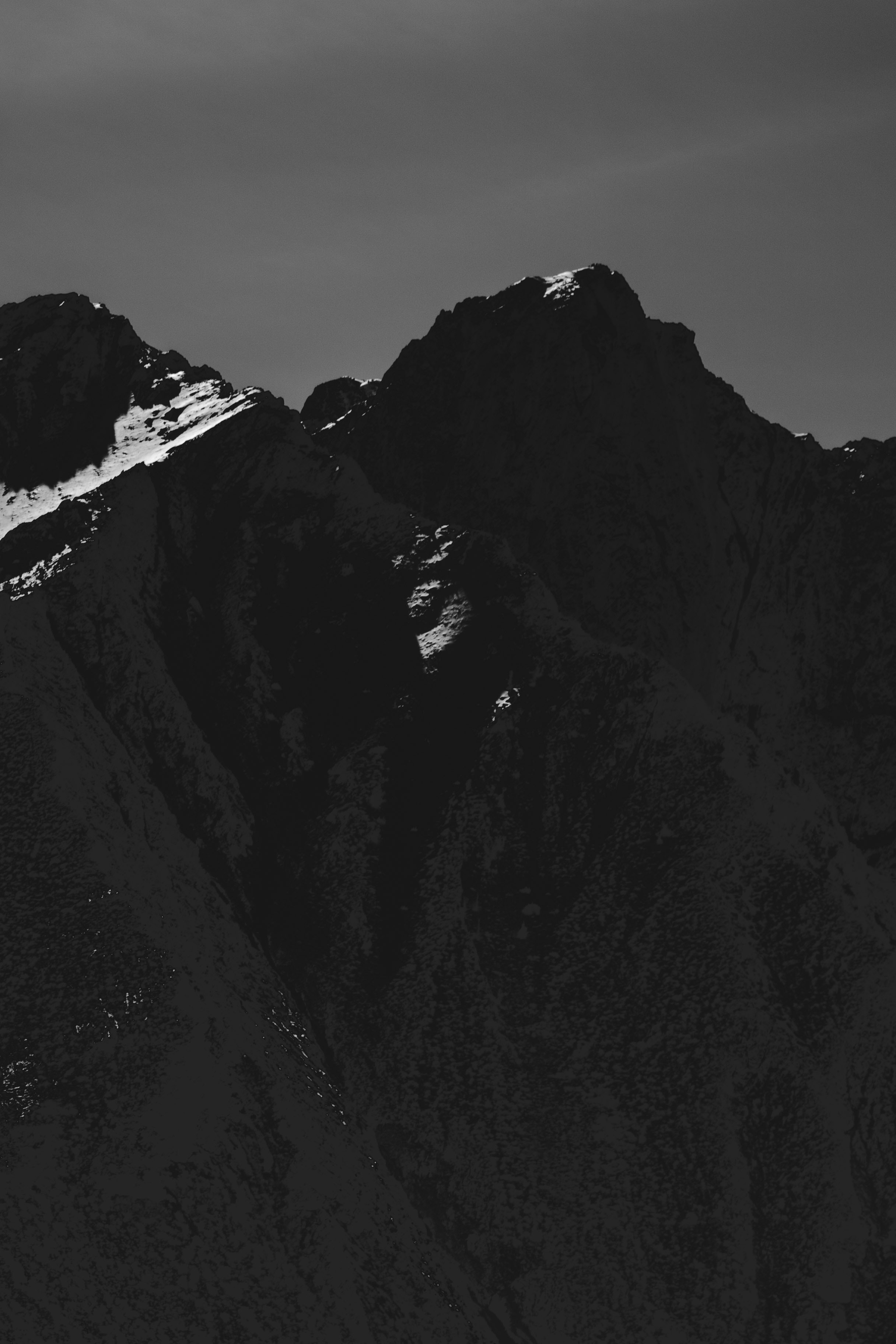 grayscale photo of snow mountain