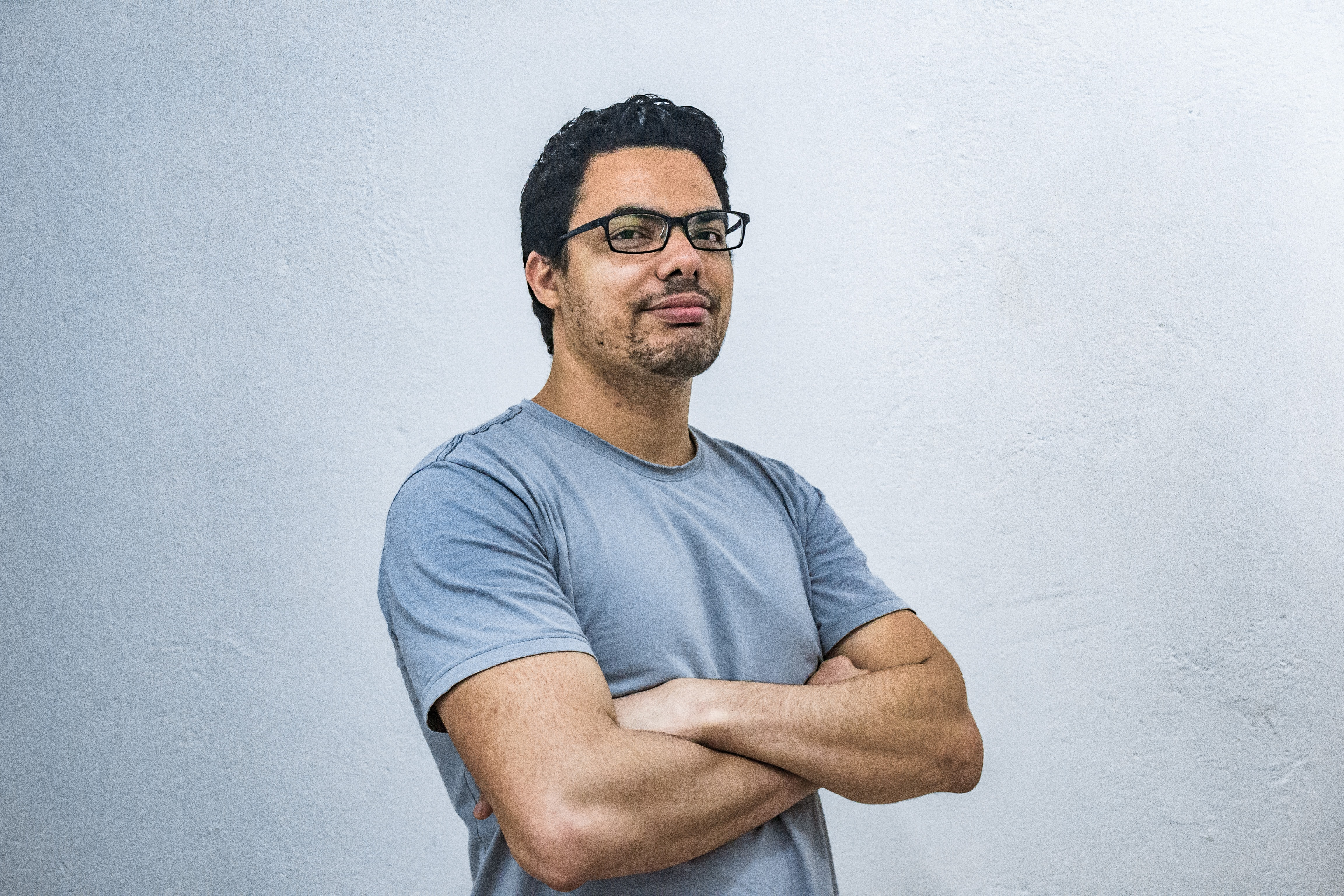 man posing in front of camera