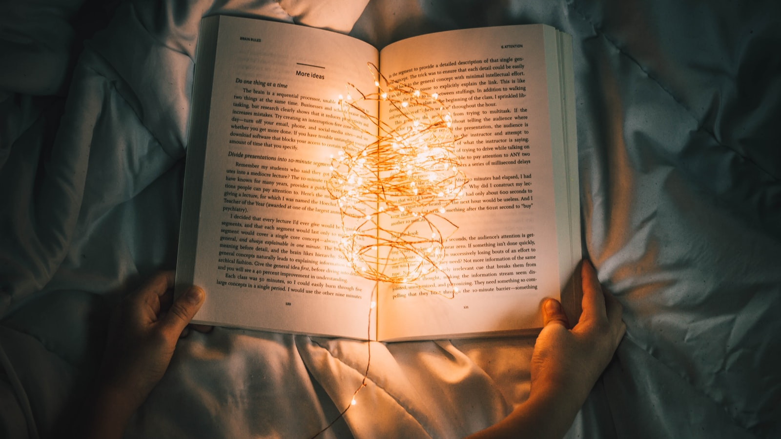 A picture of a book with lights in it. Who reads like this?