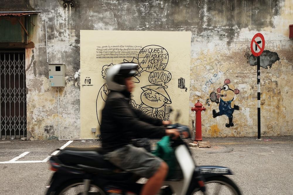 man in black jacket riding Honda motorcycle