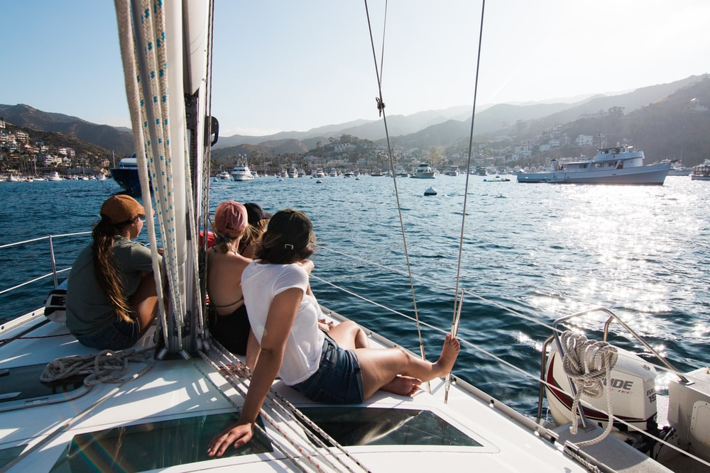 people sitting on front of yacht