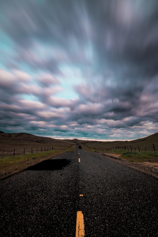 empty concrete road under blue sky