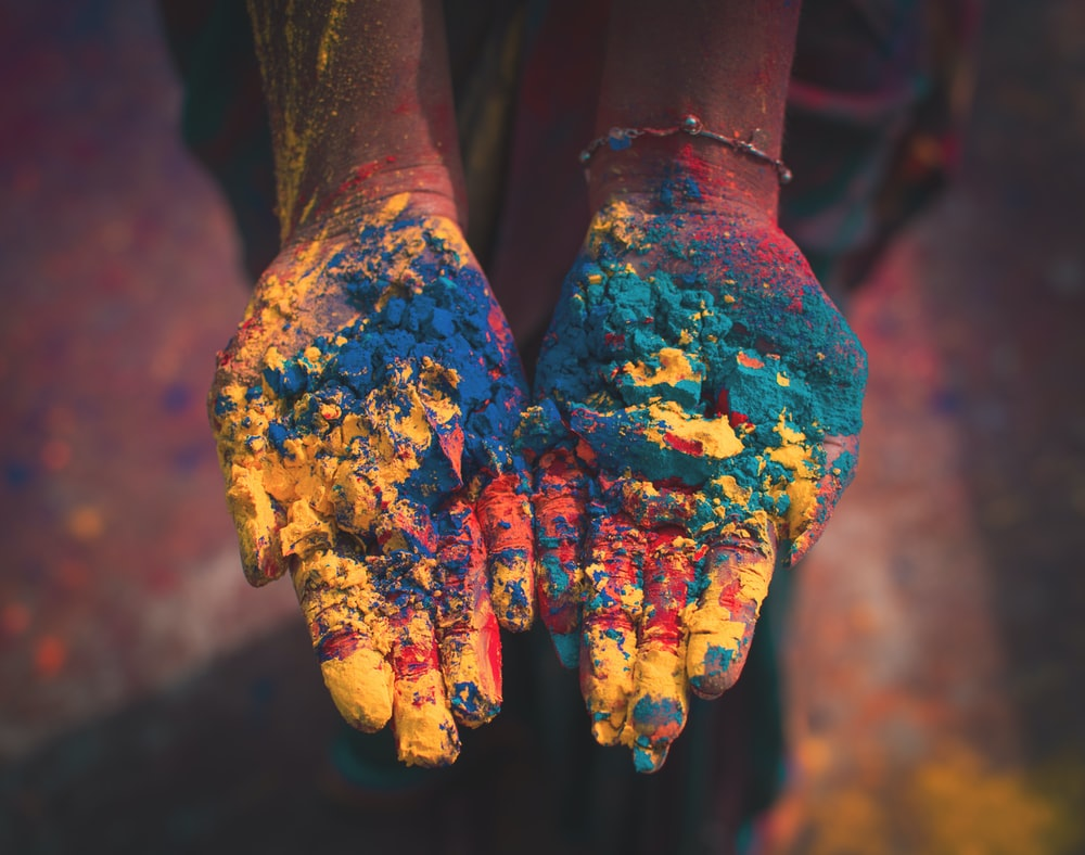 closeup photo of person holding color soils