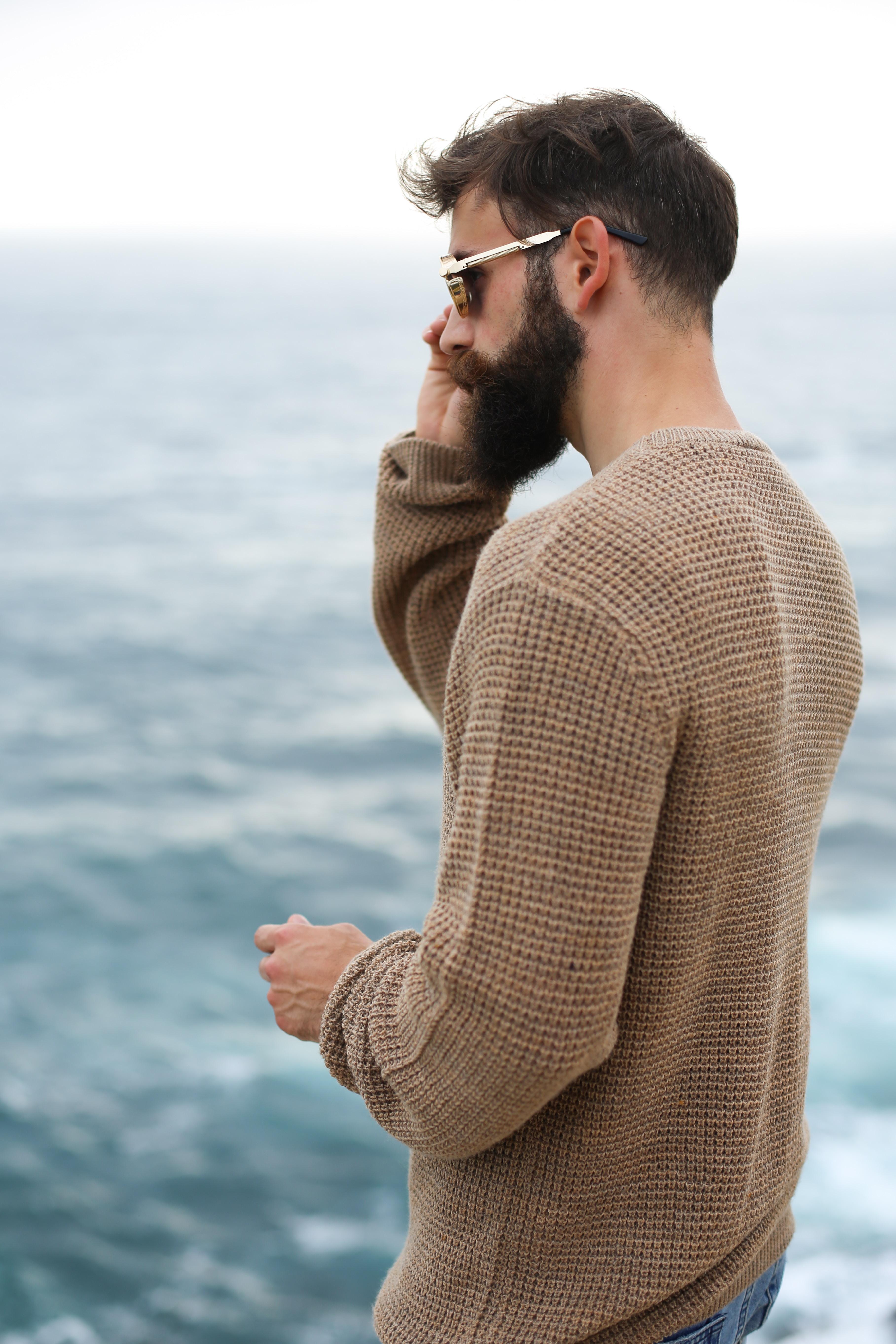 man holding his sunglasses