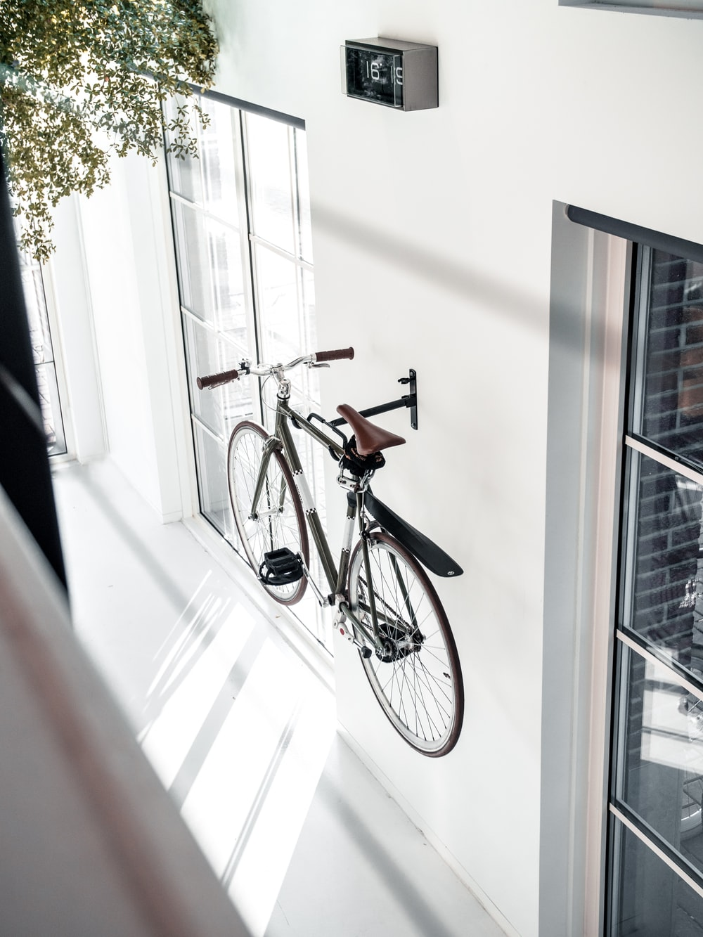 black city bike mounted in wall