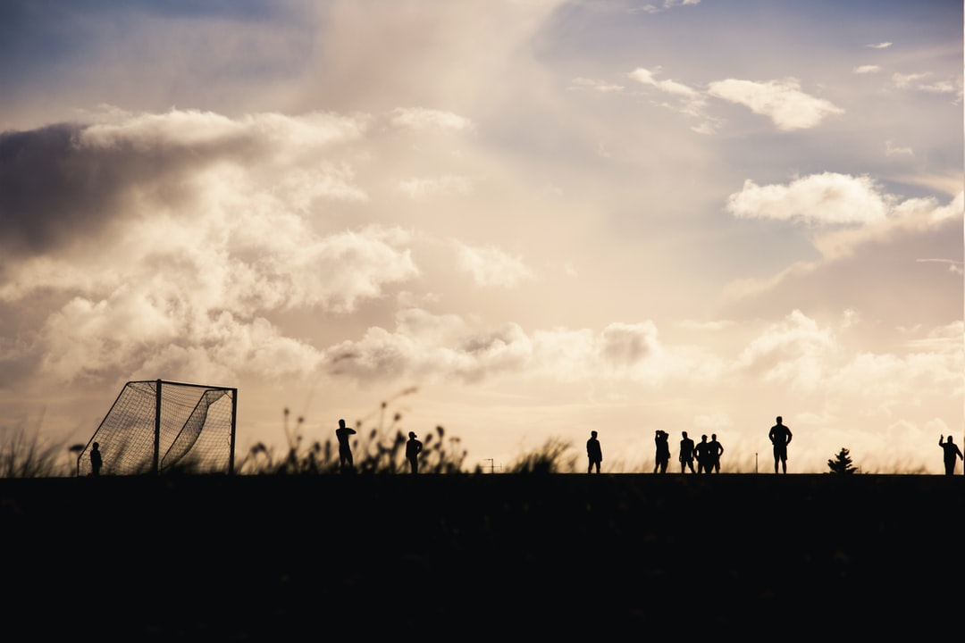 Soccer players playing in the sunset - Is soccer year-round?