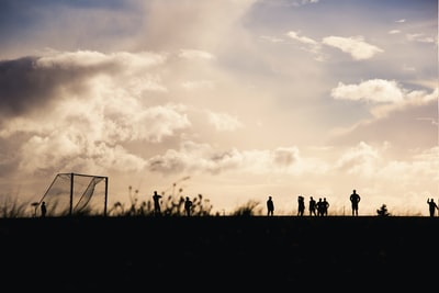 people gathering at soccer field