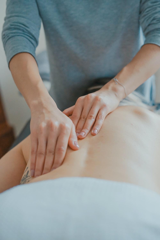 man massaging woman's body