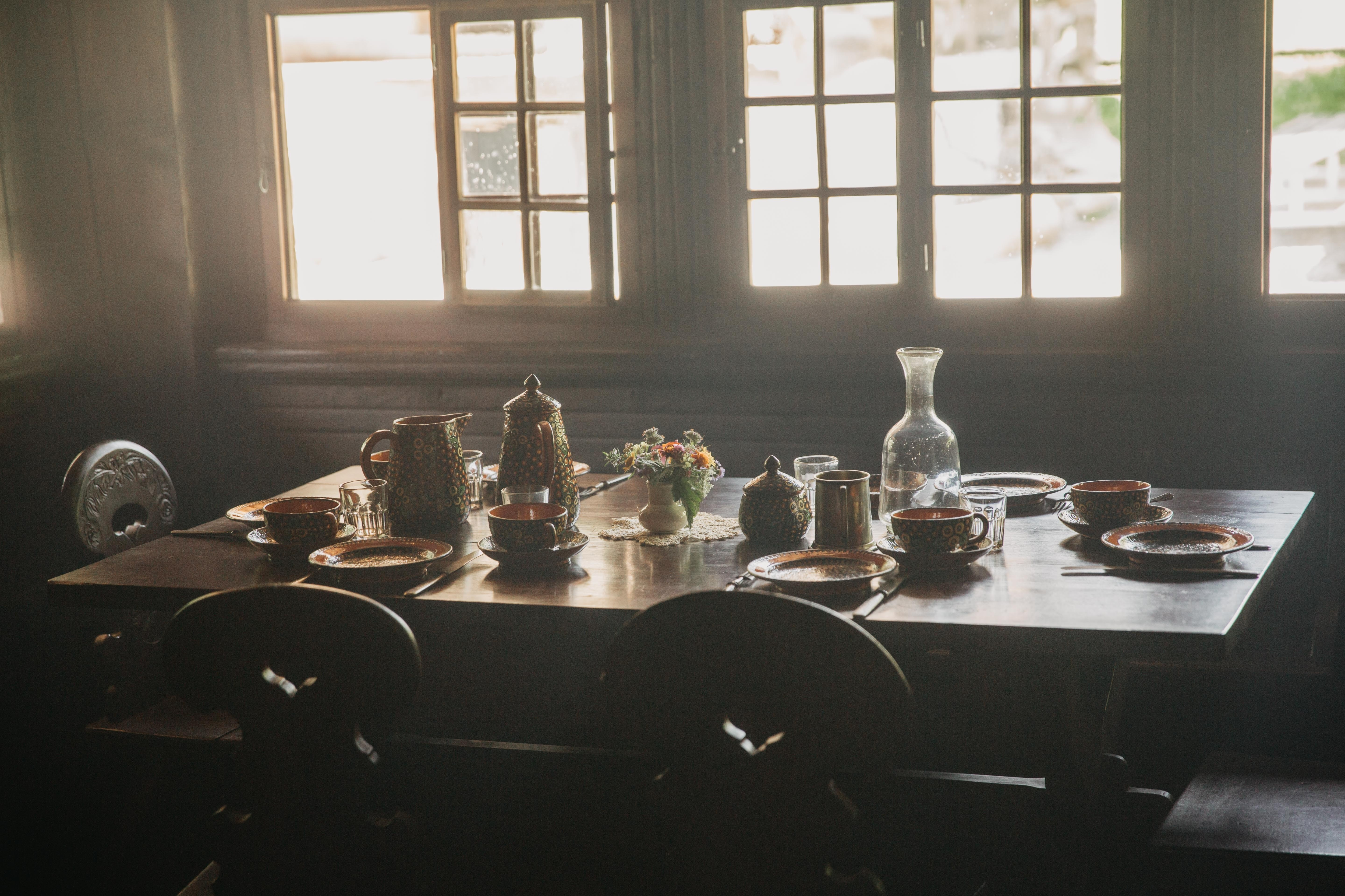 person taking photo of dining table with tablewares