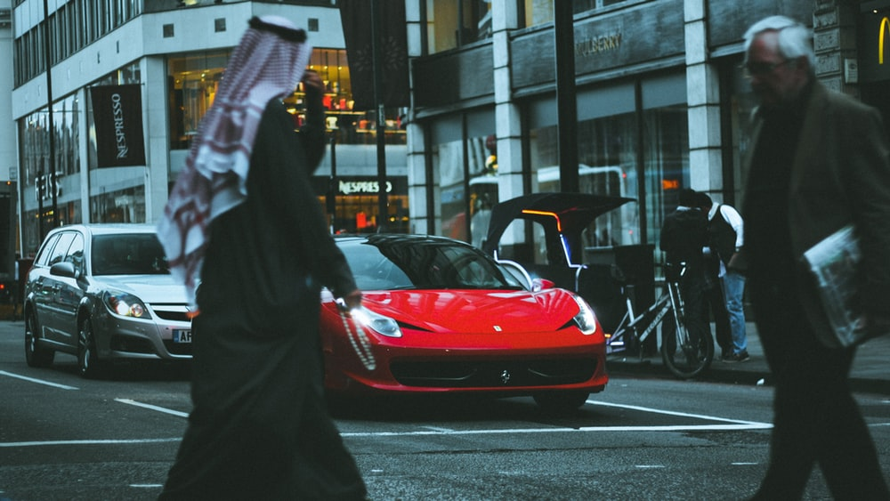 red sports car in street