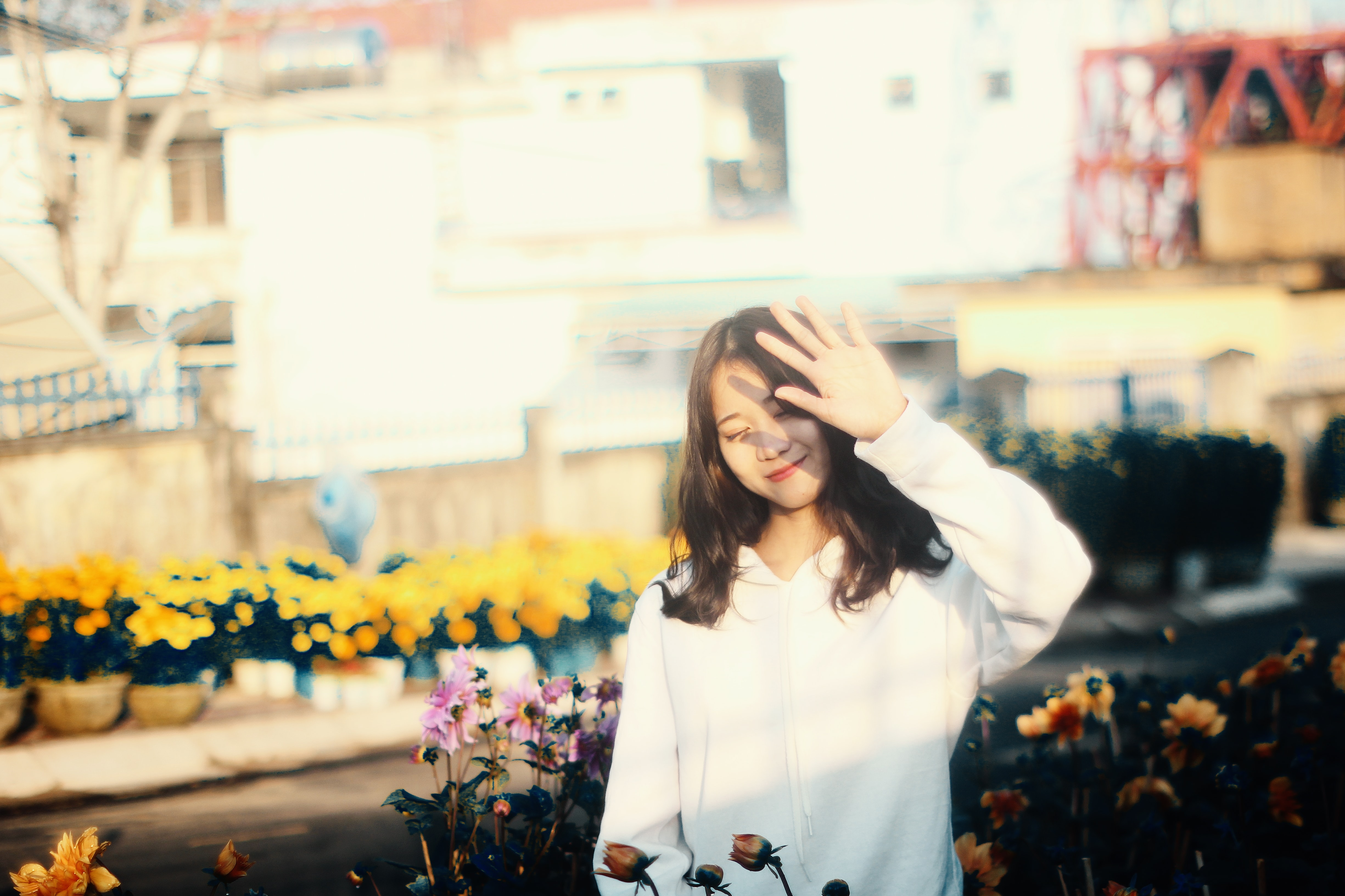 woman at the flower garden during day