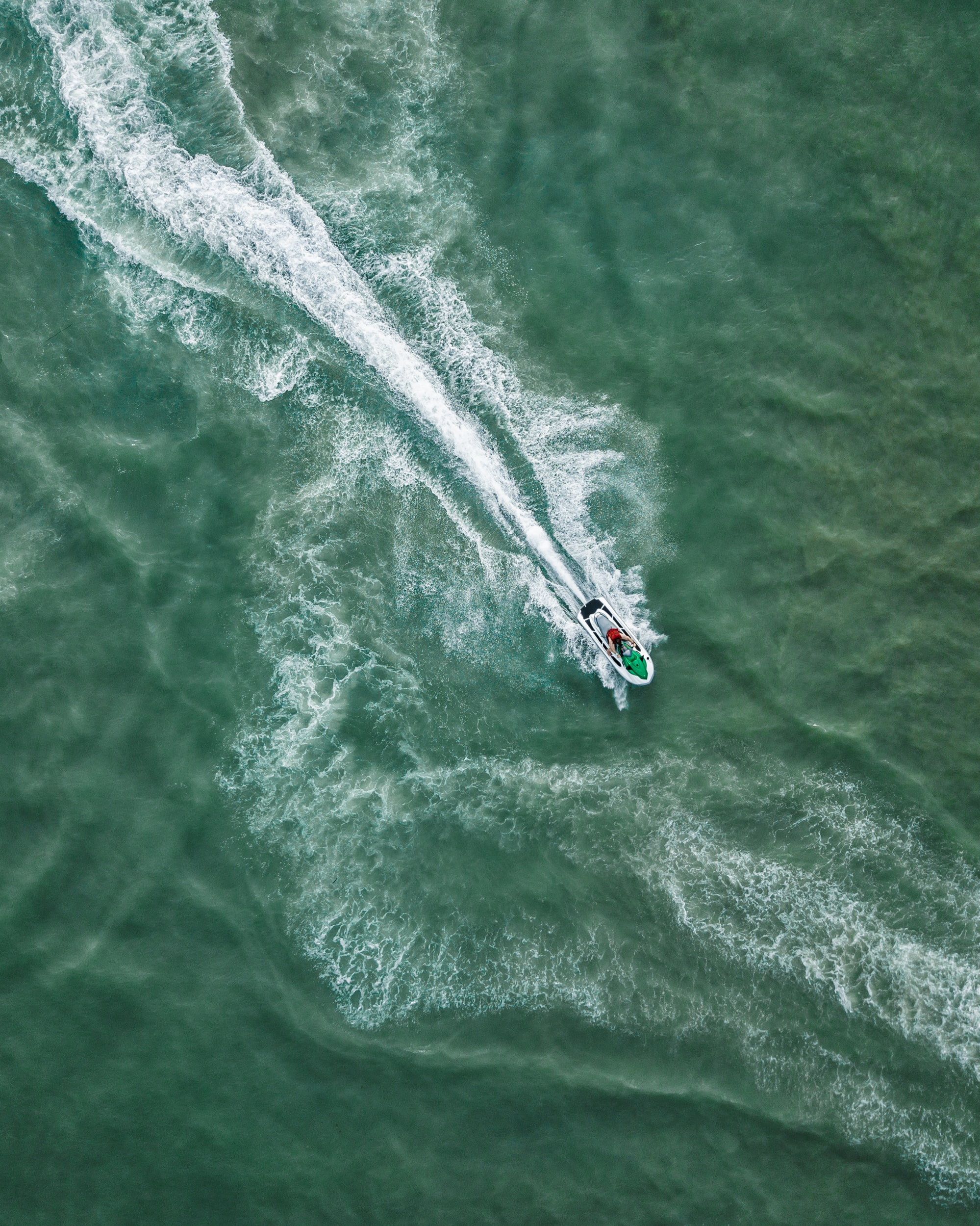 bird's eye view of personal watercraft on body of water