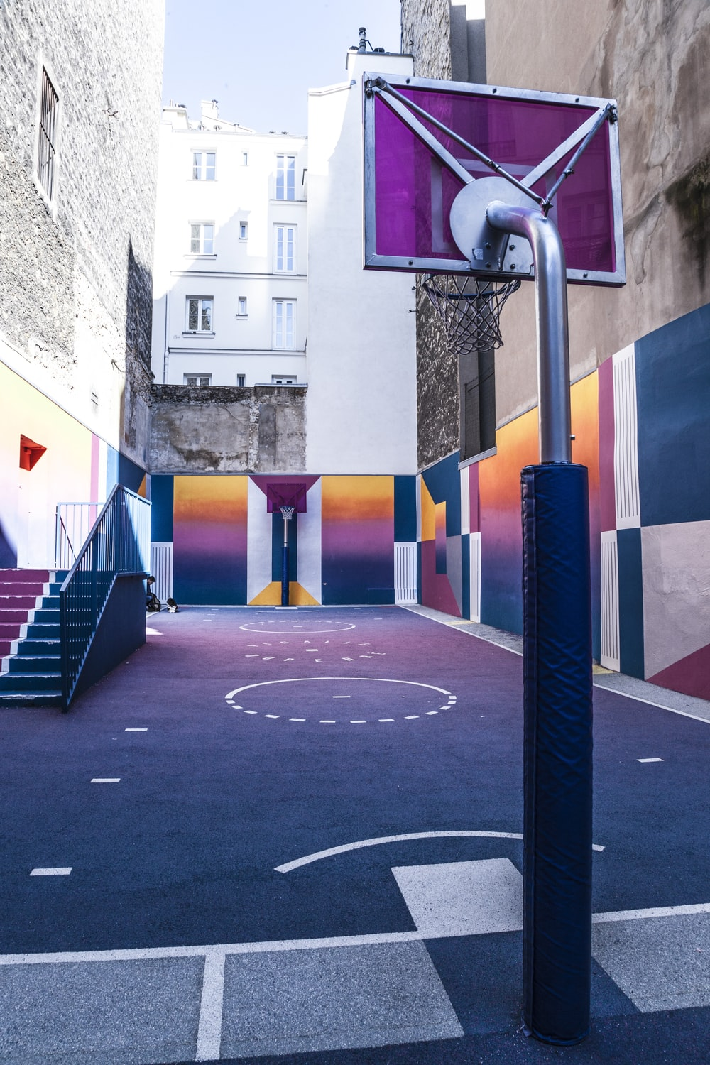 purple and orange basketball court during day time