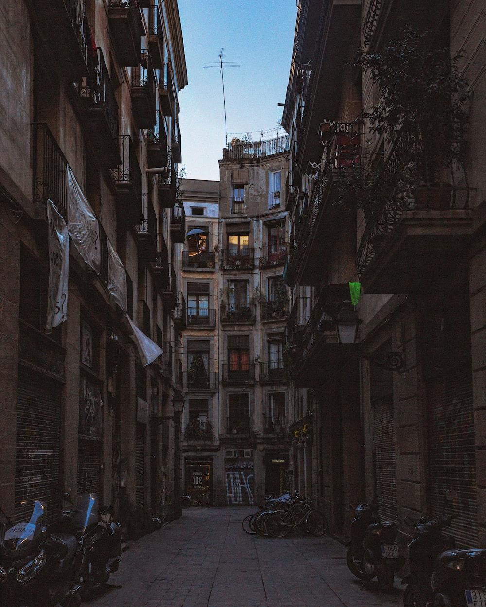 motorcycles between buildings