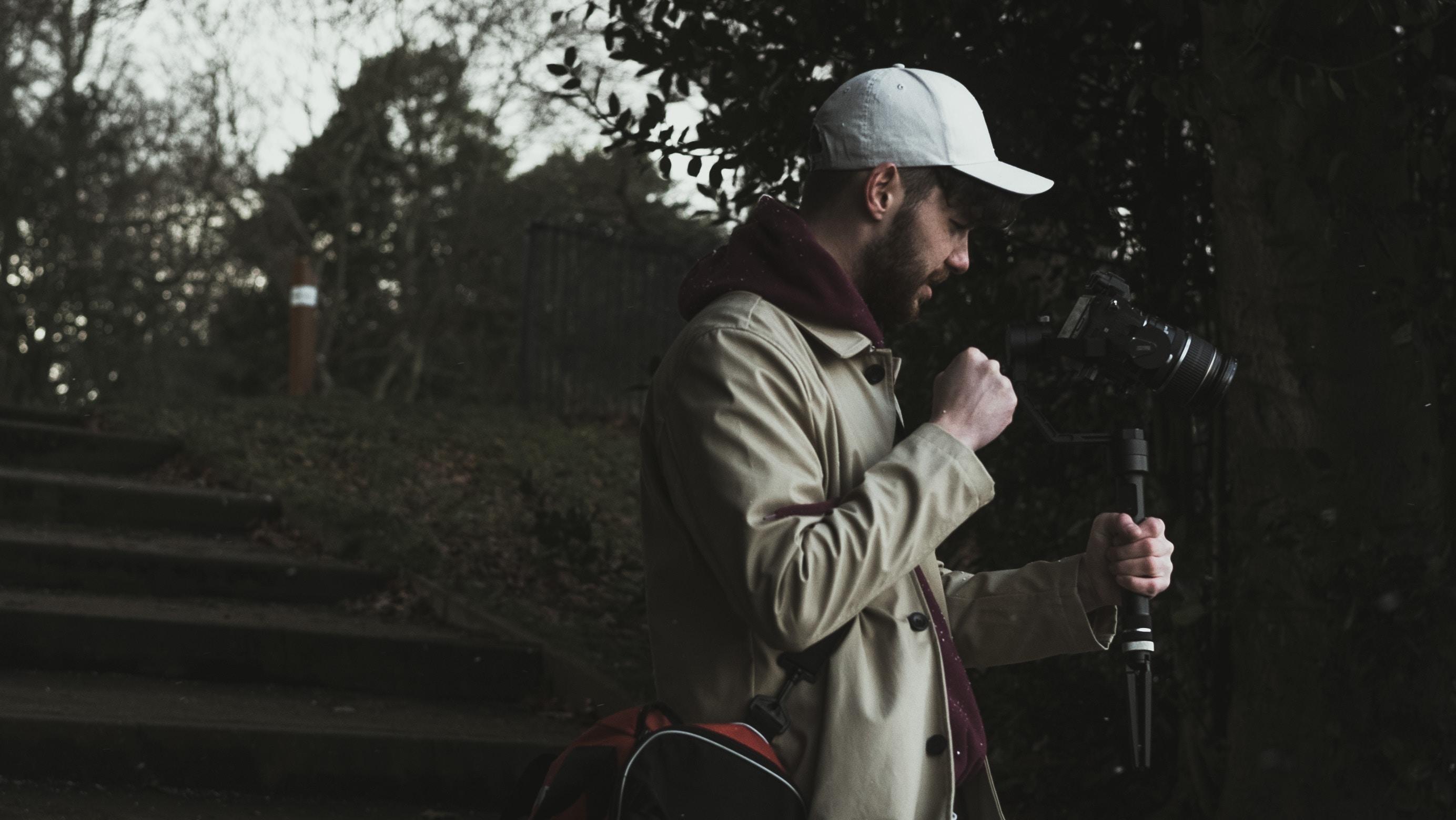 man holding camea