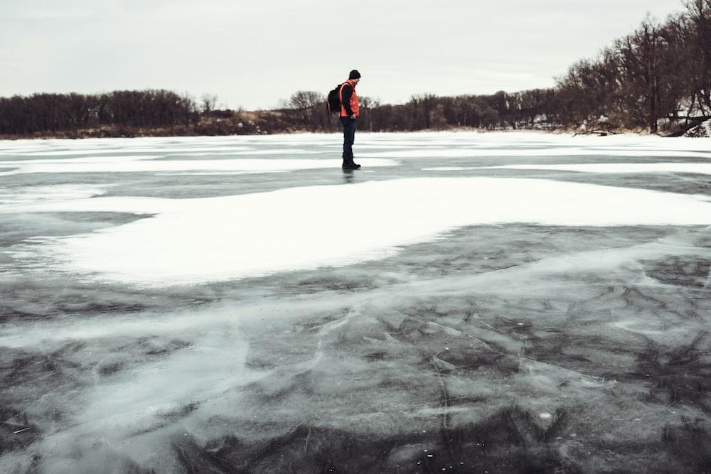 man standing on frozen water