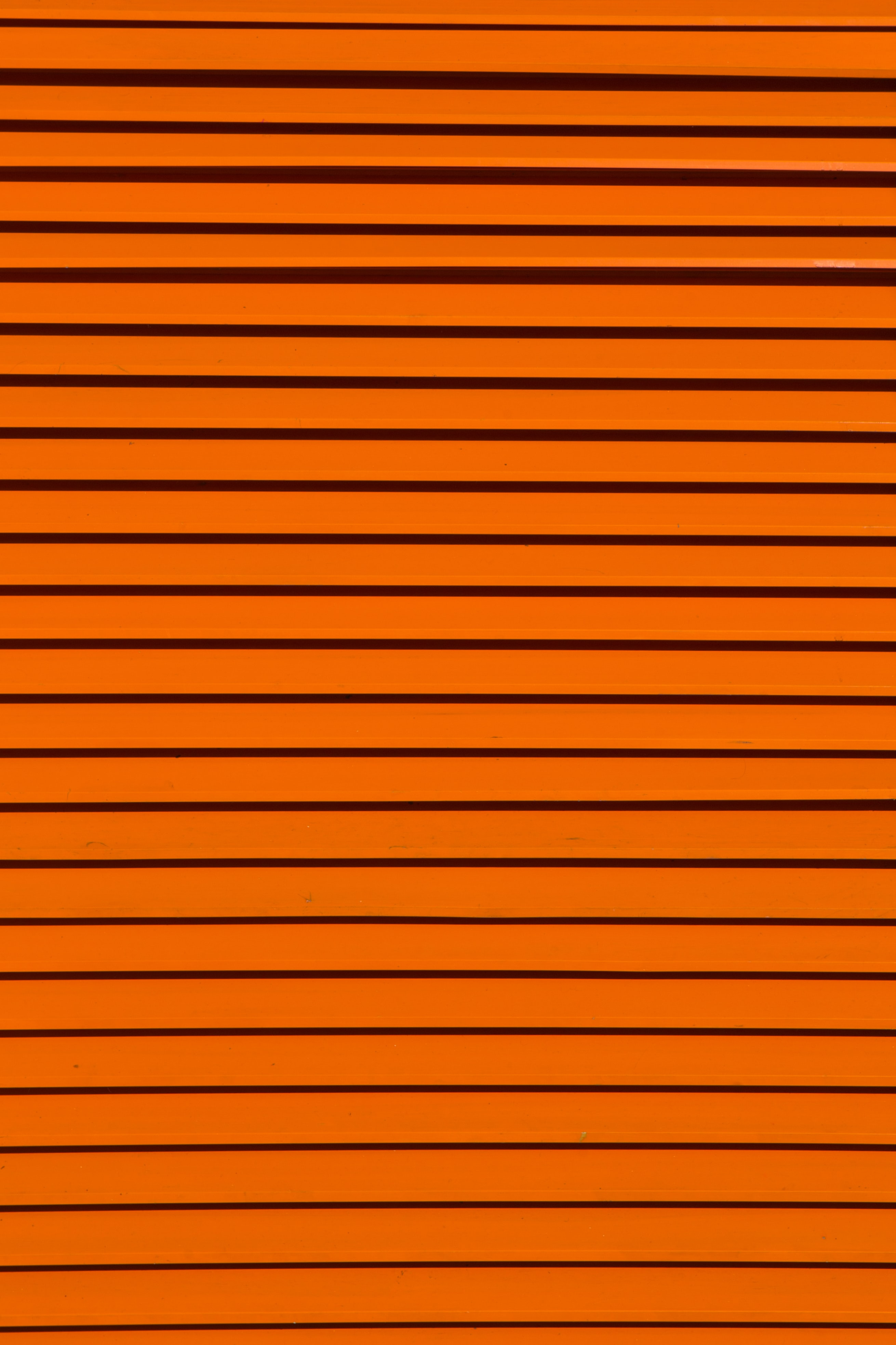 minimalist photography of orange wall